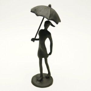 Sort jernfigur, kvinde med paraply