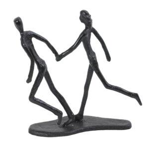 Figur i sort støbejern af et par der løber