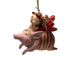 Julefigur, pige på gris