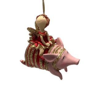 Julefigur. Pige på gris